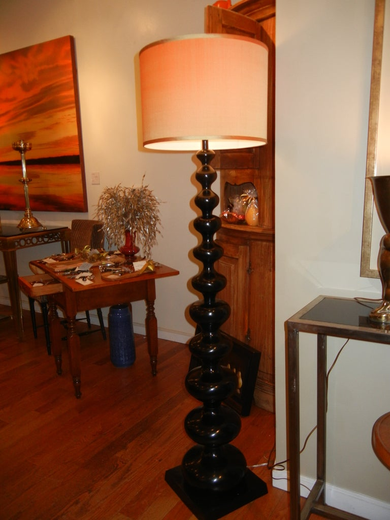 A Barley twist blackened metal floor lamp. New socket and wire, three-way off and on switch. The lamp measures 58 inches to the socket and with a drum shade (classic) it measures 64 inches.